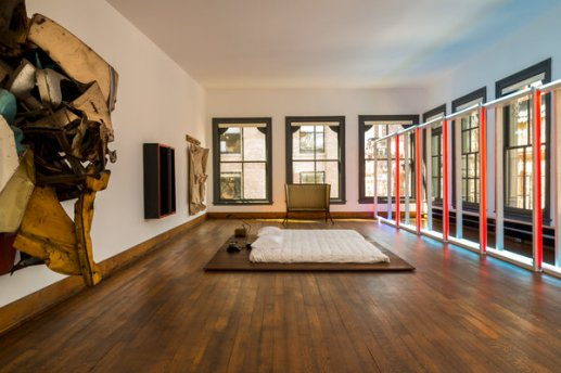"""The fifth floor of Donald Judd's home and studio at 101 Spring Street, New York, featuring (from left) John Chamberlain's """"Mr. Press"""" (1961), Donald Judd's """"Untitled"""" (1962), Claes Oldenburg's """"Soft Ceiling Lights at La Coupole"""" (1964-1972) and Dan Flavin's """"Untitled"""" (1970), photographed in 2013."""