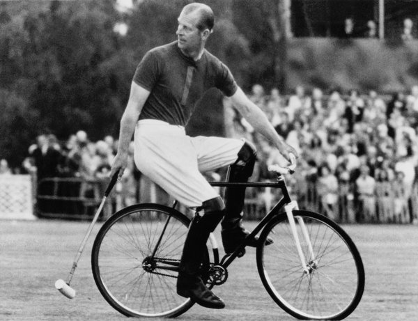 Prince Philip, an avid sportsman, at a bicycle polo game at Windsor in 1967.