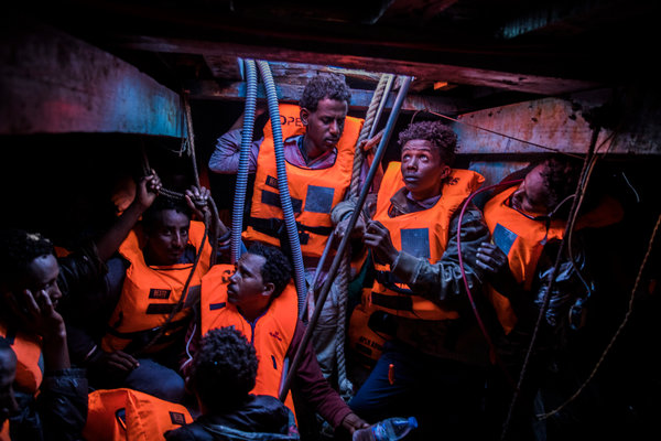 Migrants, mostly from Eritrea, on a boat off the Libyan coast in 2018.