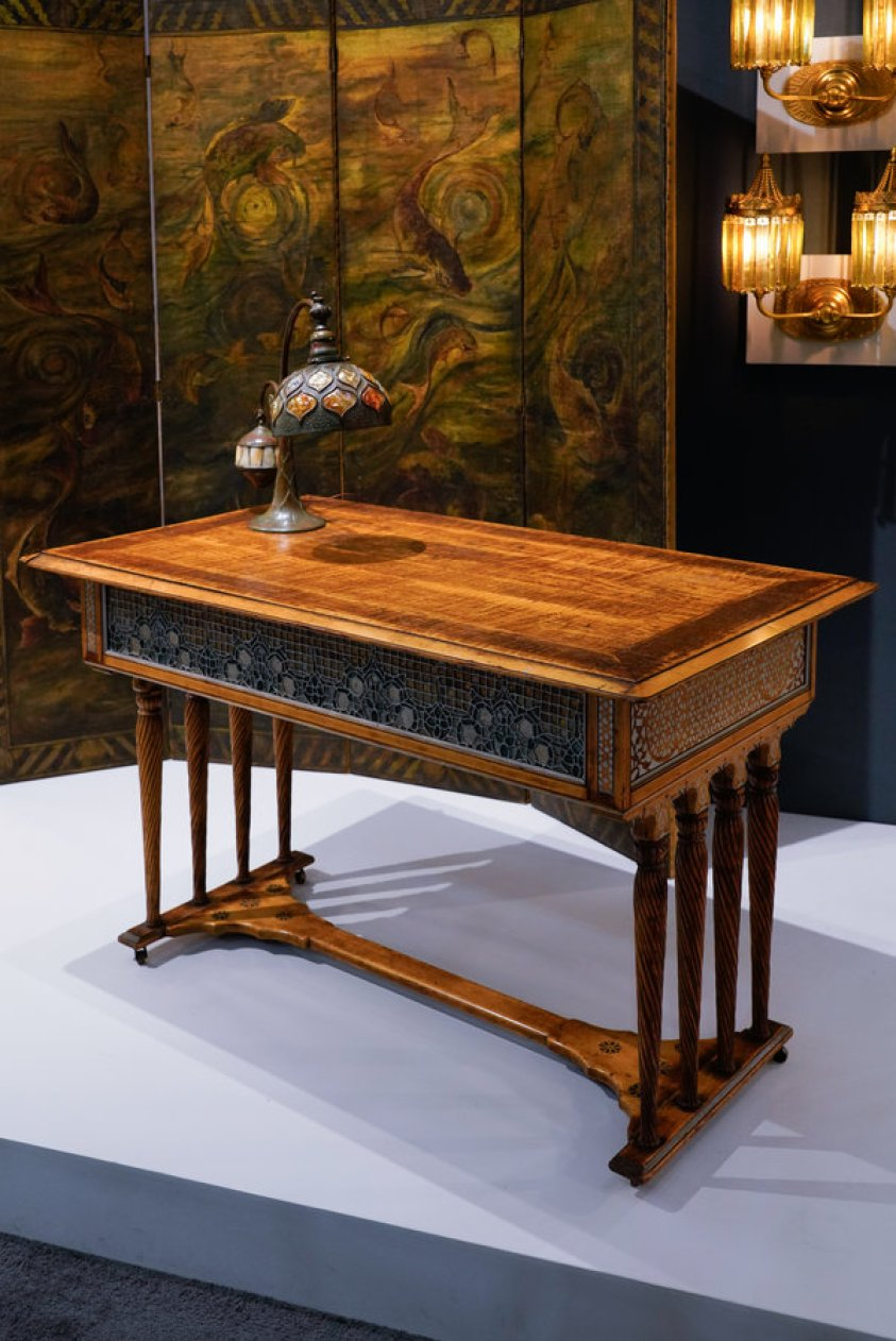From left, Wheeler's hinged screen; balance weight lamp, circa 1906, by Tiffany Studios; center table with leaded glass panels and stenciling, circa 1882-83, by Louis C. Tiffany & Co., Associated Artists; and a pair of gilt sconces, circa 1905, by Tiffany Studios, at Lillian Nassau.