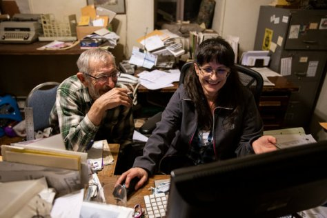 Mr. Butz and Jill Tahija, The Messenger's only other employee, working on an edition of the paper.