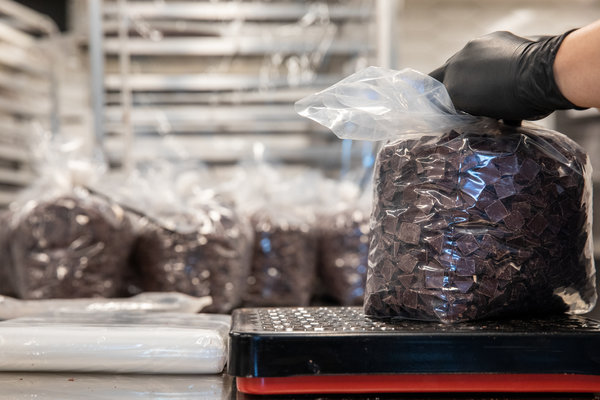 Chocolate chips being bagged at Dandelion, in San Francisco.
