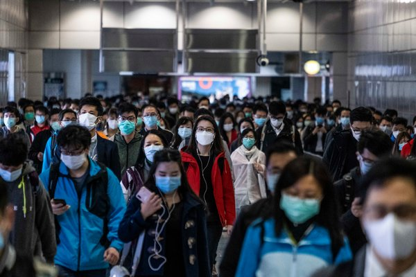 A subway station in Hong Kong on Tuesday, where commuters wore protective face masks.