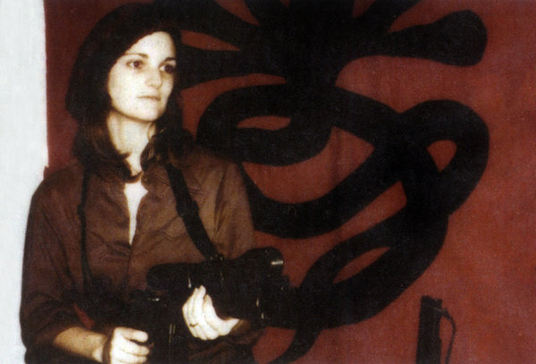 Patricia Hearst in front of a Symbionese Liberation Army flag in April 1974.