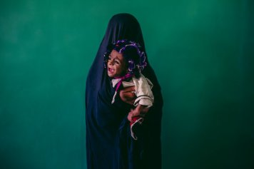 Samiullah, 8 months old and malnourished, is held by his mother, Islam Bibi, 15, at a hospital in Lashgar Gar, in Helmand Province, in September 2013.