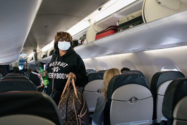 Bags Packed, Sanitizer on, Americans Travel as Coronavirus Worries ...