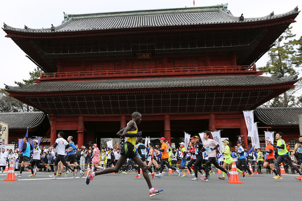 Runners passing the Zojoji Buddhist temple during the Tokyo Marathon in February 2014. The Olympic marathon will be held in the cooler, northern city of Sapporo.