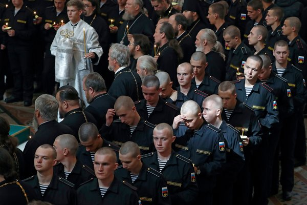 Russian sailors at a memorial service for the men who died on the Losharik.