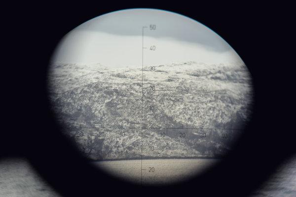The coast of Norway, near the Russian border, as seen though binoculars from a Norwegian Coast Guard ship.