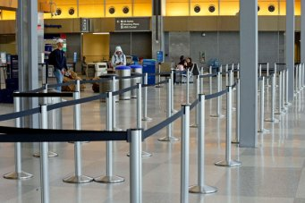 The Raleigh-Durham International Airport was mostly void of travelers at the end of March. Many nonstops from the airport have been changed to connecting flights.