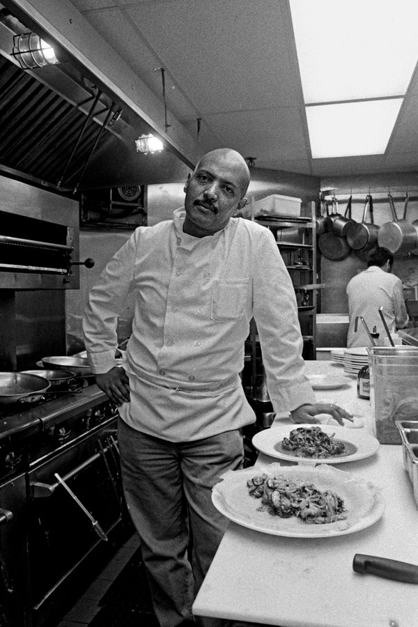 """Ficre Ghebreyesus in 2000 at Caffe Adulis in New Haven, where he introduced diners to the cuisine of his native Eritrea. Many learned only after his death that he was a painter, too. Like his cooking, his art was """"something remembered, something invented,"""" said his widow, the poet Elizabeth Alexander."""