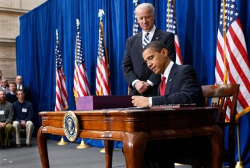 Former President Barack Obama signing the recovery bill at the beginning of his first term.