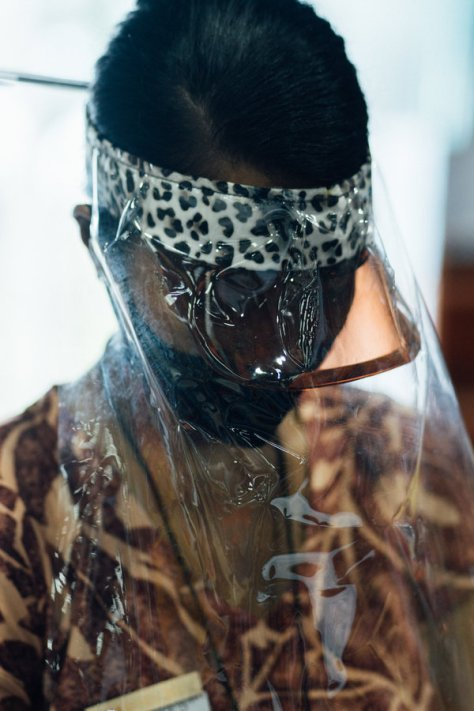 A Manu'a store employee wears multiple layers of masks in Tafuna.