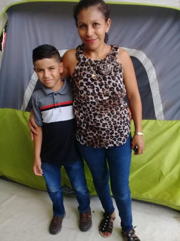 Sandra Rodríguez with her son Gerson, 10.