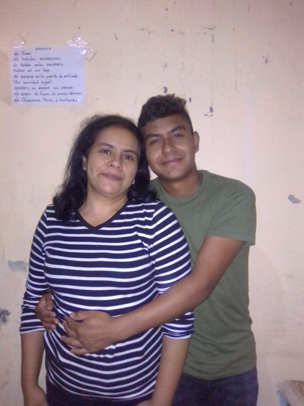 Pedro Buezo Romero with his mother. Pedro said he was even more vulnerable now than he was when he decided to leave for the United States.