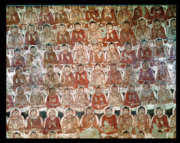 A painting of a multitude of sitting Buddhas on the walls of Ajanta, the caves of Maharashtra, India. Believed to have been created between the first and second centuries B.C. and the fifth century A.D., the caves are one of the oldest Buddhist sites in the world.