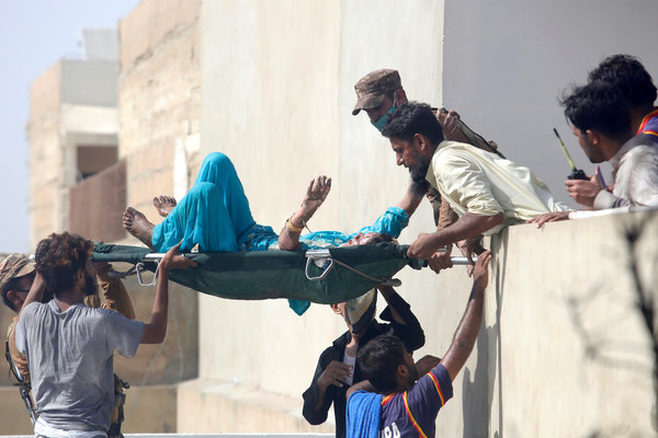 Carrying one of the injured.