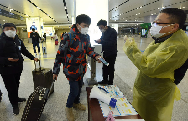 At a railway station in Hangzhou, China, in February, a traveler showed his health code: green, meaning his infection risk was low.