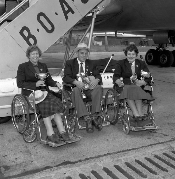 Ms. Maughan, left, returning from the 1960 Paralympic Games in Rome with her fellow medal winners  Dick Thompson and Barbara Anderson.