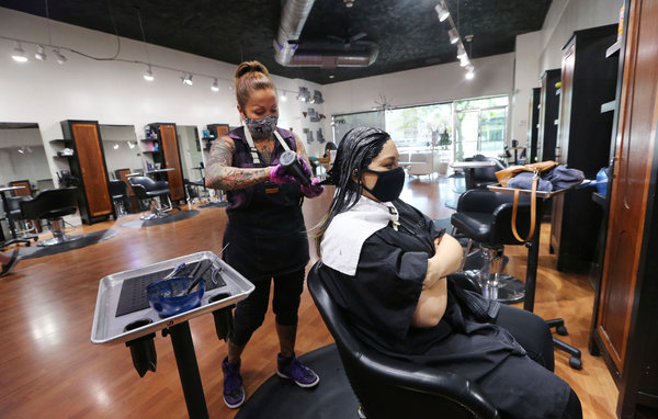 Sandra Serrano, a stylist, colored Norma Beltran's hair at the Atomic Kitten Salon on May 19, in Bakersfield, before stylists and barbers were officially allowed to return to work.
