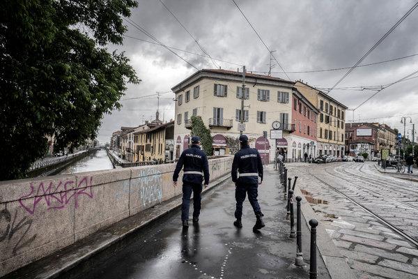 Local police officers on patrol in the Navigli neighborhood of Milan.