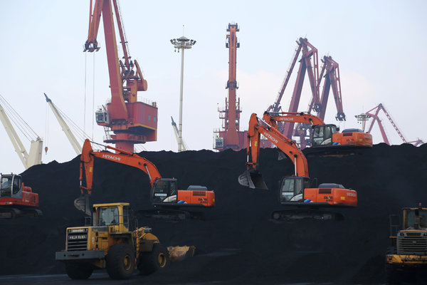 Imported coal being unloaded at a port in Lianyungang, China, in December.