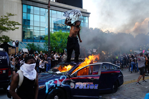 A burning police car during a protest in Atlanta on Friday.