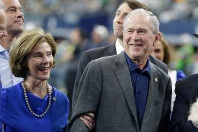 Former President George W. Bush and his wife, Laura, in October. He will not support President Trump's re-election.