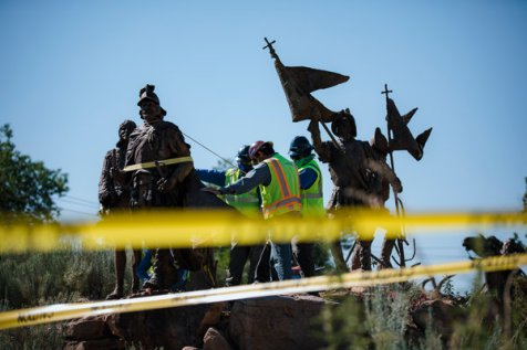 A crew removed the statue of Juan de Oñate from outside the Albuquerque Museum in Albuquerque on Tuesday.