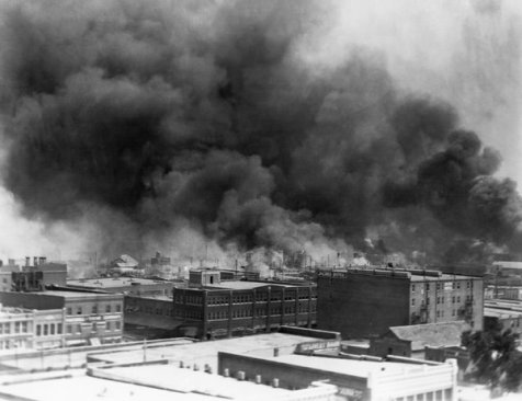 Smoke billowed up from fires set during the Tulsa Race Massacre in June 1921.