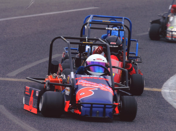 Wallace, foreground, racing in a go-kart as a young boy.