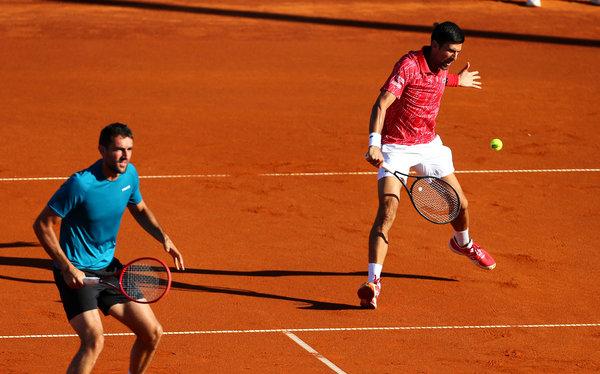 Novak Djokovic, right, and Marin Cilic playing in Croatia on Friday.
