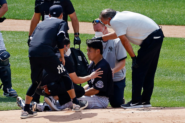Masahiro Tanaka was attended to by Yankees trainers after being struck by a line drive off the bat of his teammate Giancarlo Stanton.