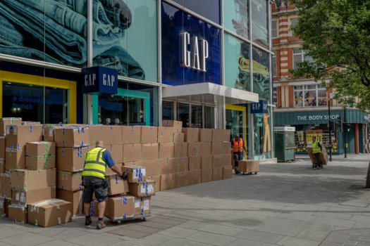 Workers in May stacked boxes from a shoe store closing down on a deserted Oxford Street in London.