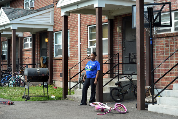 Shirley Cross, a member of the Hudson/Catskill Housing Coalition, outside her home in a public housing complex, where nearly 70 percent of residents are Black.