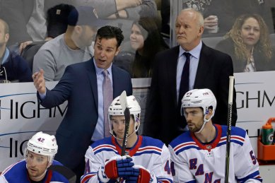 Former New York Rangers assistant coach Lindy Ruff (right)