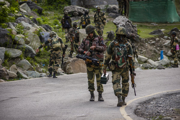 Indian Border Security Force soldiers patroling a highway bordering China.