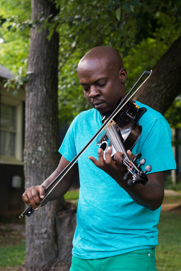 Ashanti Floyd, who helped organize the musicians at a violin vigil last month in honor of Elijah McClain, outside his home in Marietta, Ga.