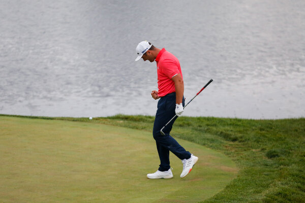 Jon Rahm celebrated on the 16th green at the Memorial Tournament on Sunday. Rahm took a two-stroke penalty for causing his ball to move slightly before chipping onto the green but held onto his lead.