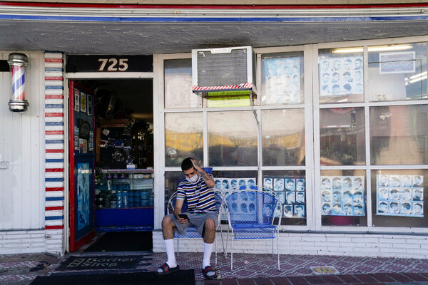 Anthony Milinkovich waited for his turn for a haircut, outside George's Barber Shop last week in San Pedro.