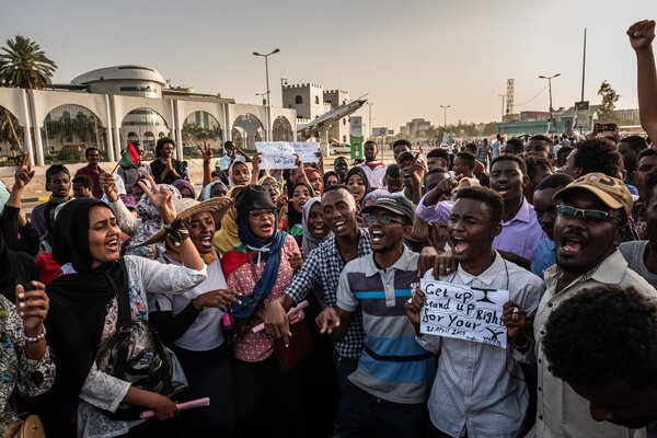 Protesters chanting revolutionary songs in front of Sudan's military headquarters in Khartoum last year.
