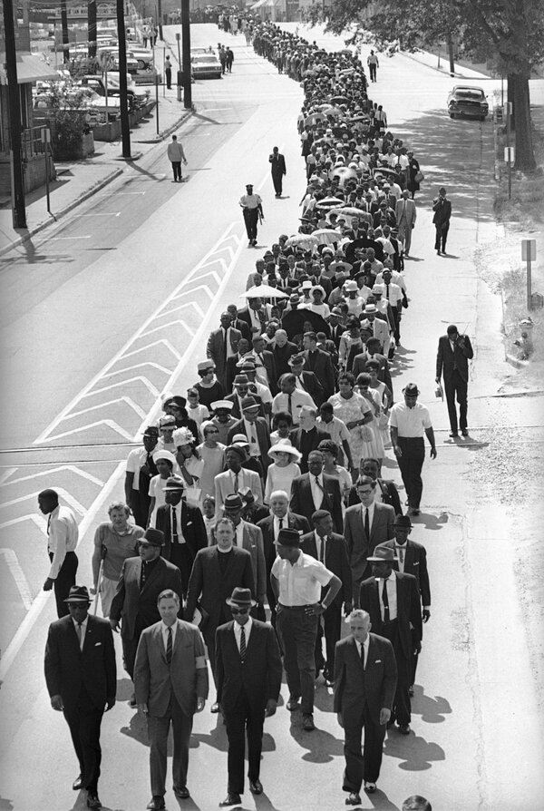 Mr. Evers, far left in foregound, led a march in Jackson, Miss., in 1966 to mark the third anniversary of Medgar Evers's assassination. With him were, from left, the lawyer John S. Stillman, Roy Wilkins of the N.A.A.C.P. and the lawyer R. Jess Brown.