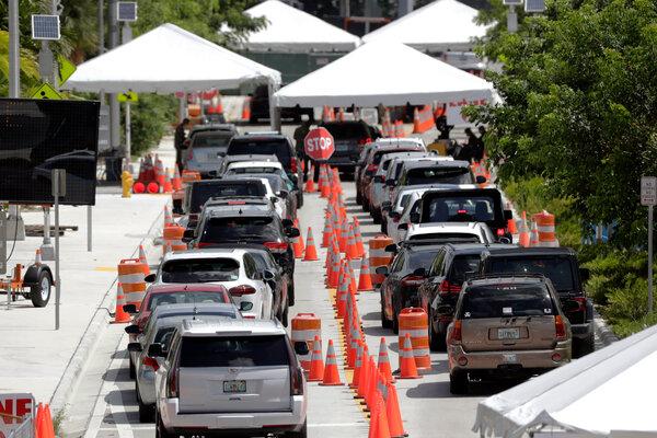 Long lines at a drive-through coronavirus testing site in Miami Beach, Fla., last month.