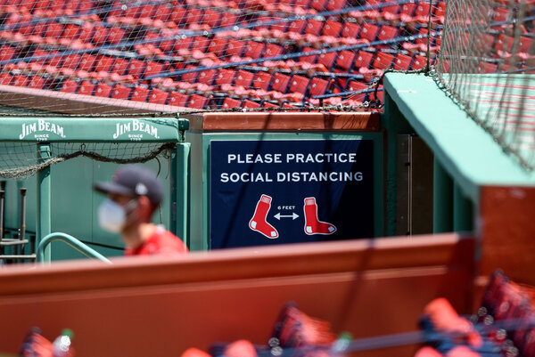 A sign at Fenway Park reminded players and staff members to keep their distance from one another.
