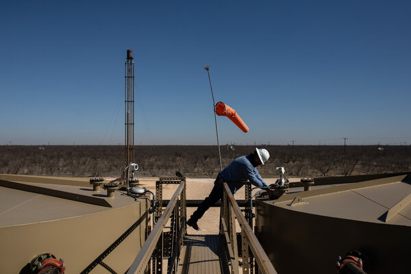 """A Parsley Energy field technician gauging a production tank east of Midland, Texas. The president of the company said the Biden plan had """"a lot of room"""" for oil and gas."""