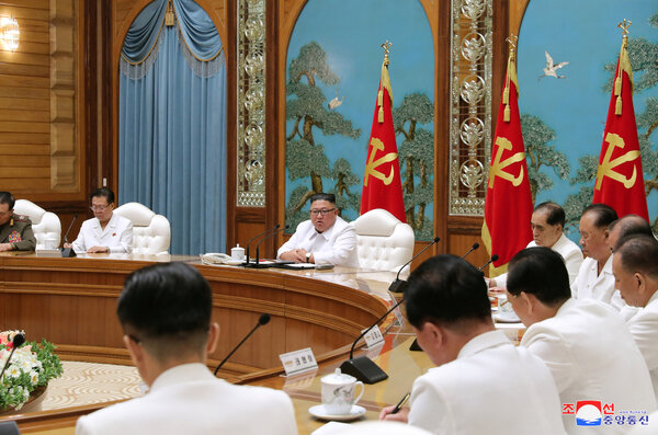 Kim Jong-un, North Korea's leader, at what state-run media said was a high-level emergency meeting. The North said a returning defector might have brought Covid-19 into the country.