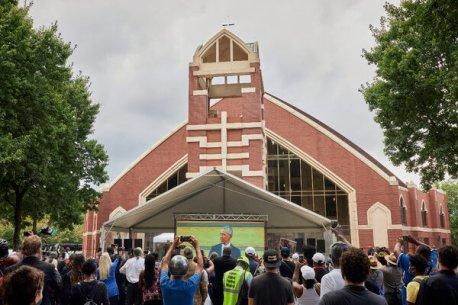 Mourners watched a screen outside Ebenezer Baptist Church as President Barack Obama spoke inside.