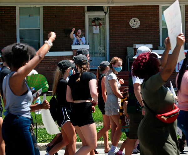 A Black Lives Matter demonstration in June in Collinsville, Ill. Mr. Trump's move to stoke racial divides after nationwide protests over police brutality against Black Americans has helped alienate voters in certain suburban districts.