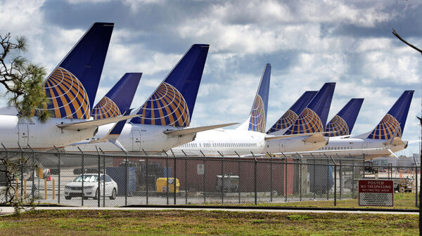 United Airlines planes are parked at Orlando International Airport, in a Tuesday, April 7, 2020.