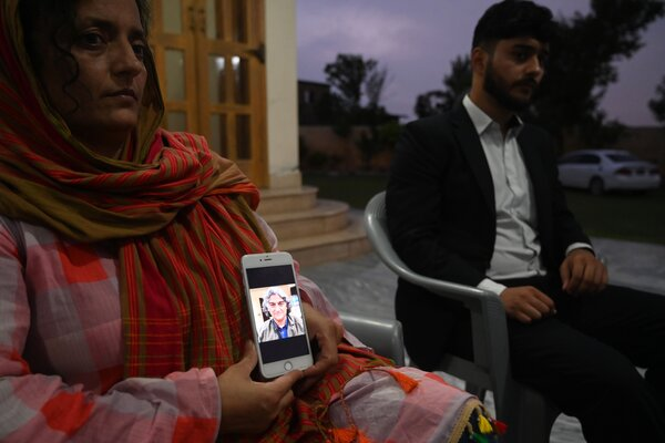 Security: Kaneez Sughra, wife of the seized Pakistani journalist Matiullah Jan, shows a photograph of her husband. Mr. Jan was abducted from a street in Islamabad, Pakistan's capital, in late July.